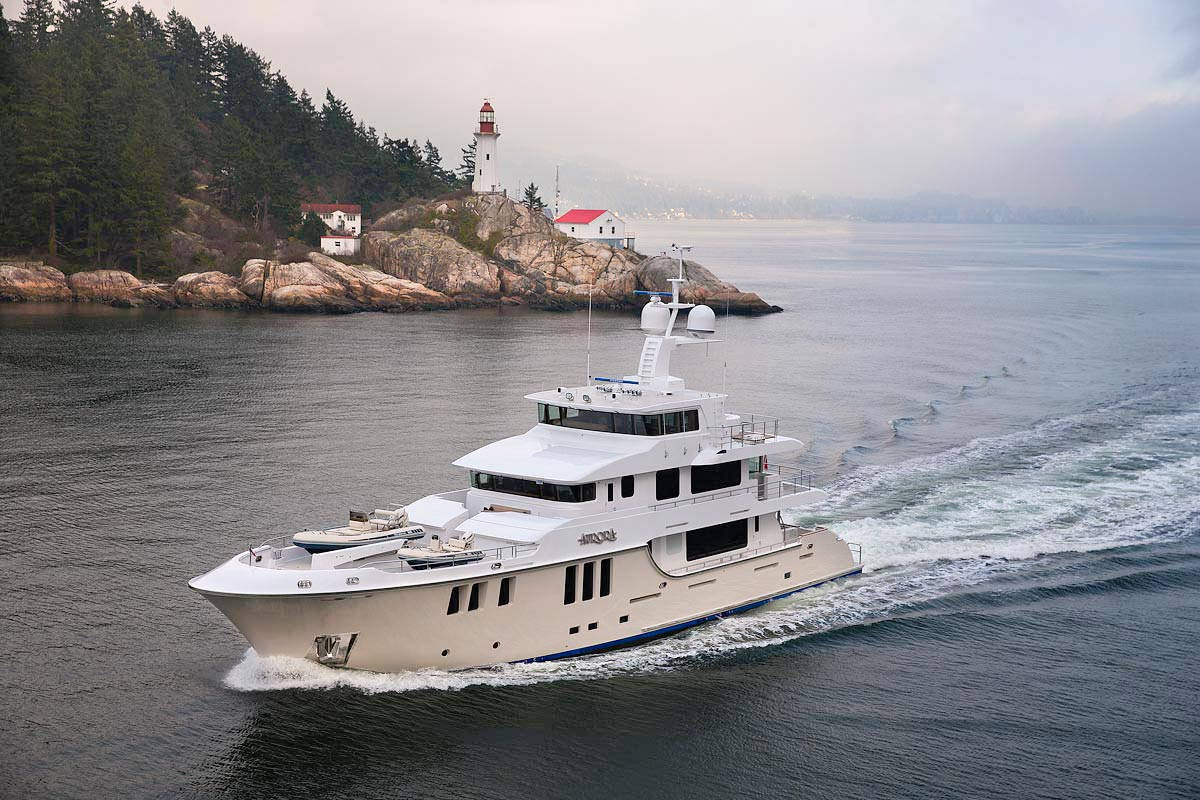 M/Y Aurora Cruising past a lighthouse