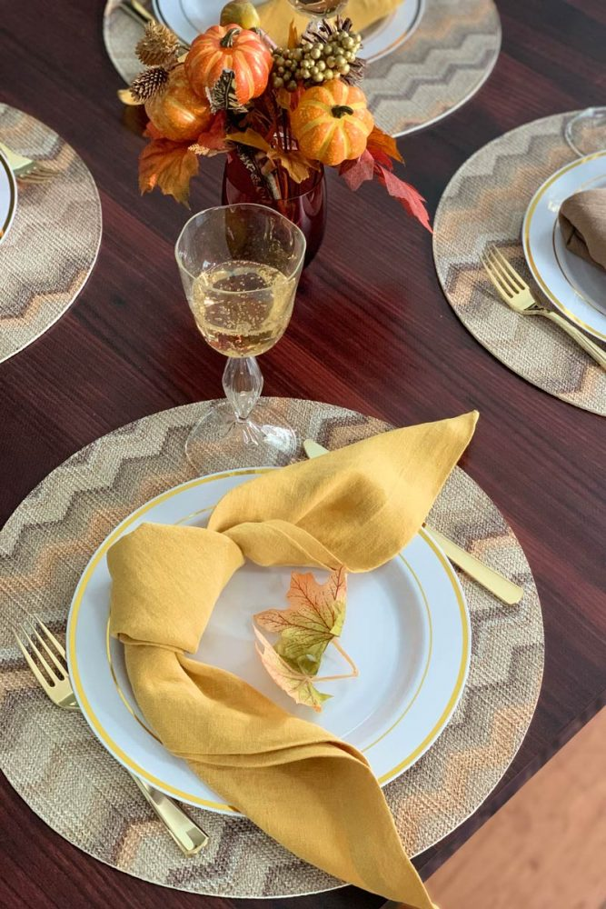 A fall tablescape featuring a gold placemat from Bargello
